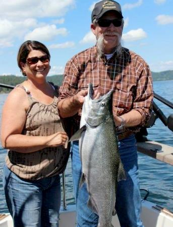 Roger and Laura Eubanks caught this 18 pound salmon was caught on a Frisky Jenny Seahawk Fly while fishing with Don of Lake Charters.